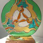 Three Hares Dancing Around the Moon (stained glass art)
