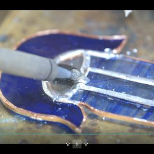 Hamsa hand being soldered