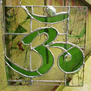 Om in green