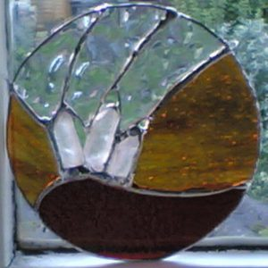 Red and amber quartz crystal stained glass roundel